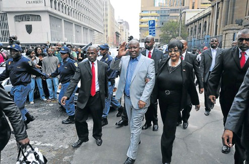 ?? Pictures: Gallo Images and AFP ?? Winnie Madikizela-Mandela supported Julius Malema throughout his hate speech trial in Johannesburg in 2011.