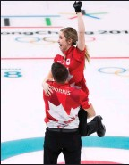 ?? The Associated Press ?? Canadians Kaitlyn Lawes and John Morris win gold during mixed doubles curling action at the 2018 Winter Games in South Korea.