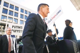 ?? Tom Brenner / New York Times 2018 ?? Former National Security Adviser Michael Flynn arrives at a district court in Washington to be sentenced in 2018. He admitted lying to FBI agents.