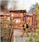 ?? NOAH BERGER/AP ?? Communities such as Healdsburg, Calif., found themselves overtaken by wind-driven flames.