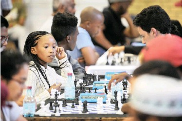 ?? | ARMAND HOUGH African News Agency (ANA) ?? AMAHLE Zenzile, 10, from Crossroads Chess Club competed against advanced players at the 2018 Chess Summer Slam tournament at the Rylands Civic Centre yesterday.