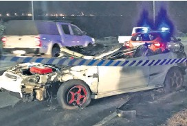 ??  ?? The wreck of the car which ploughed under the trailer of a truck at the EcoJunction intersection on 22 July, leading to a renewed call for traffic lights to be urgently installed Laurie Smith