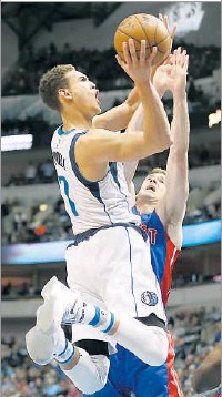 ?? Jae S. Lee/Staff Photographer ?? Dwight Powell is 17 for 58 from 3-point range this season after making only five 3-pointers over his first two seasons in the NBA. Powell went 4 of 8 on 3-pointers and scored a career-high 21 points Sunday against Phoenix.