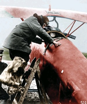 ??  ?? ■ This famous photo of Manfred von Richthofen, encumbered in flight gear and wearing heavy fur covered flying boots, shows him climbing into the cockpit of 'Le Petit Rouge', his all-red Albatros D.III, at Rocourt.