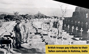 ??  ?? Bri­tish troops pay trib­ute to their fallen com­rades in Ko­hima, In­dia