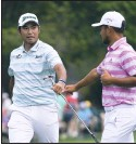 ?? AP PHOTO ?? Hideki Matsuyama, left, and Xander Schauffele congratulate themselves after their eagles on the 15th hole during Saturday's third round of the Masters.