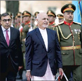 ?? Anadolu Agency ?? PRESIDENT Ashraf Ghani, center, has said he will stay in office until elections determine Afghanistan's next leader. The Taliban is adamant on his removal.