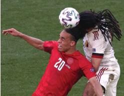 ?? (Reuters) ?? DENMARK FORWARD Yussuf Poulsen (left) vies for the ball with Belgium's Jason Denayer during last night's Euro 2020 clash in Copenhagen, won 2-1 by the Belgians.