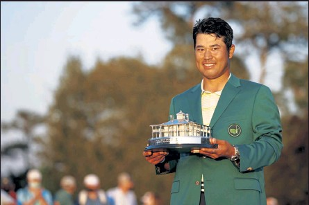 ?? JARED C. TILTON / Getty Images ?? Hideki Matsuyama poses with the Masters trophy after winning the Masters on Sunday at Augusta National Golf Club in Augusta, Ga.