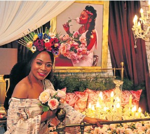 ?? Pictures: John Liebenberg ?? Actress Nomzamo Mbatha with the display of roses that were named for her.