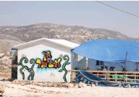 ??  ?? RESIDENTS SIT at a structure in Evyatar earlier this week. (Marc Israel Sellem/The Jerusalem Post)