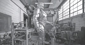 ?? USA TODAY NETWORK ?? Nadine Chronopoulos grinds and sands the RoboCop statue.