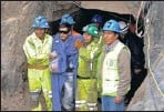 ?? By Job Rosales via AP ?? Rescue: Miner Javier Tapia, wearing sunglasses, is helped out of the mine in Peru on Wednesday.