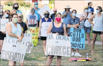 ?? JOE MAHONEY/TIMES-DISPATCH ?? Supporters of a choice between in-class or online instructio­n for Chesterfie­ld County students listened to speakers at a rally prior to a July school board meeting.