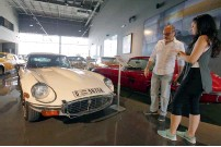 ??  ?? GOTTA LOVE THE JAGUAR ... Visitors check out a Jaguar E type 1971 at Nostalgia. The showroom's collection also includes newer models.