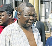 ?? Picture: AFP ?? The late Zimbabwe opposition leader Morgan Tsvangirai seen here leaving court in Harare after he was arrested and severely beaten by police in 2007.