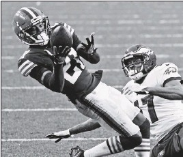 ?? THE ASSOCIATED PRESS ?? Cleveland cornerback DenzelWard (21), sidelined with a strained calf, and end Myles Garrett, out with COVID-19, are the Browns' top two defensive players.