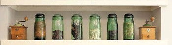??  ?? Glass jars filled with dried beans, lentils and spices add interest to a set of plain kitchen shelves.