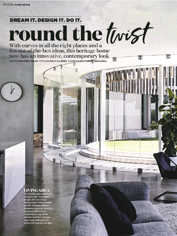 ??  ?? The dramatic glass wall floods this space with natural light. At night, the 'GyroFocus' fireplace from Oblica provides warmth. A slimline Objekto 'Paulistano' armchair from Hub Furniture is offset by the Customweave rug, Jardan ottoman and 'Neo' sofa...