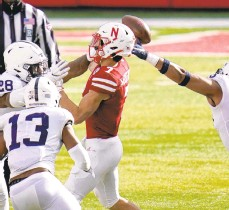 ??  ?? Nebraska quarterbac­k Luke McCaffrey (7) throws an intercepti­on while under pressure from Penn State defensive end Jayson Oweh (28), defensive end Shaka Toney (right) and linebacker Ellis Brooks (13) during the second half Saturday in Lincoln, Neb.