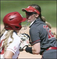 ?? (NWA Democrat-Gazette/Charlie Kaijo) ?? Alabama infielder Kaylee Tow (right) tags out Arkansas' Hannah Gammill during the fifth inning Sunday at Bogle Park in Fayetteville. More photos at arkansasonline.com/412alaua/