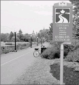 ?? PHOTOS BY JANICE KENNEDY FOR THE OTTAWA CITIZEN ?? Most of Ottawa's 540 kilometres of cycle routes are scenic and well signed. Travelling by bike encourages you to slow down and admire some of the smaller details.