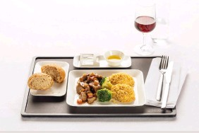 ??  ?? Main Course in Business Class Veal ragout braised in vegetable jus