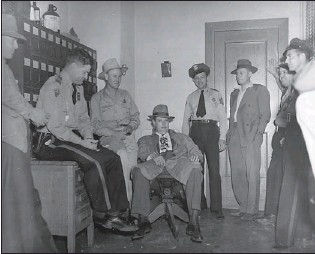 ??  ?? Above: Law enforcement officers and other officials who participated in the Phantom Killer investigation gather in the Miller County Sheriff's Office in June 1946. The group included Miller County Chief Deputy Tillman Johnson, Arkansas State Police...