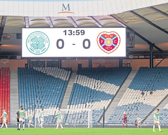 ??  ?? As well as the scoreline, the Hampden scoreboard could be indicating the number of fans inside the National Stadium when Celtic went on to beat Hearts on penalties in the Cup Final last December and retain the trophy