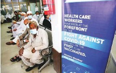 ?? AP ?? People wait to receive the Sinopharm vaccine in Peshawar. The situation in the country is extremely critical, officials said.
