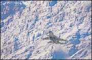 ?? PTI ?? An Indian Air Force fighter jet flies in the backdrop of Himalayan mountain ranges, amid de-escalation efforts by India and China in eastern Ladakh, in Leh, on March 4.