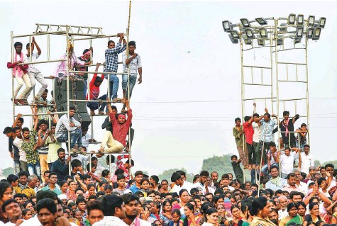 ?? PTI ?? Supporters listen to an address by Telangana caretaker chief minister and TRS chief K Chandrashekar Rao in Nalgonda district. The TRS and BJP are contesting in all 119 seats, but the Congress party has fielded candidates in only 94 constituencies.