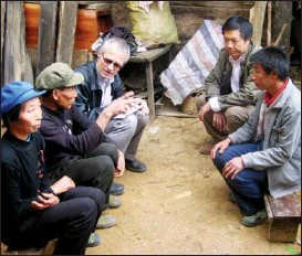 ??  ?? Hermann interacts with villagers during one of his many trips to rural China.