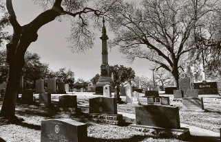 """?? Joe Holley / Contributor ?? The memorial to Gov. Edmund J. Davis in the Texas State Cemetery in Austin towers over all the others. Davis has a key role in the first chapter of """"A Single Star and Bloody Knuckles."""""""