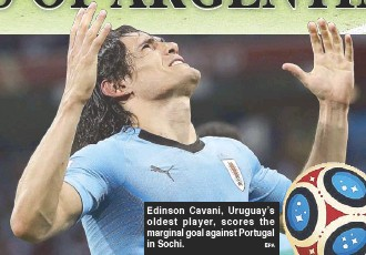 ?? EPA ?? Edinson Cavani, Uruguay's oldest player, scores the marginal goal against Portugal in Sochi.