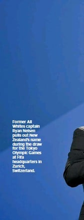 ??  ?? Former All Whites captain Ryan Nelsen pulls out New Zealand's name during the draw for the Tokyo Olympic Games at Fifa headquarters in Zurich, Switzerland.