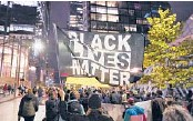 ?? WARREN/AP TED S. ?? Protesters representing Black Lives Matter and Protect the Results march last year in Seattle. A financial snapshot shared with The Associated Press shows the BLM Global Network Foundation took in just over $90 million in 2020.