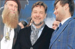 ?? Getty. ?? Russell Crowe flanked by friend Charlie Allan, left, and Douglas Booth.