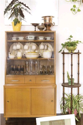 """??  ?? """"I LOVE THIS HUTCH because it's not too huge, and a lot of midcentury hutches are enormous,"""" notes Emily. The hutch holds some of her Franciscan ware and midcentury barware."""