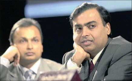 ?? Picture: AP ?? Reliance Industries chairman Mukesh Ambani, right, and vice-chairman Anil Ambani listen to a shareholder at the 30th annual general meeting in Mumbai, India. Anil and his brother Mukesh – ranked by Forbes magazine as the world's 34th and seventh...