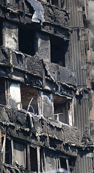 ??  ?? Walls of flame: Firemen said the Grenfell Tower ignited 'like a firelighter', with the polystyrene-like cladding – meant to protect the 24-storey block – appearing to provide a fatal conduit for the fire. The building was left as a burnt out-husk