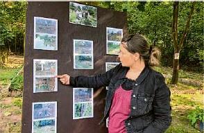 ?? Fotos (3): Claudia Braun ?? Kristin Roock vom Jugendsozialverbund Strausberg zeigt anhand von Vorher-nachher-aufnahmen, was aus dem Nachbarschaftsgarten geworden ist.