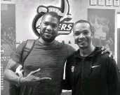 ?? Twitter ?? In a photo posted in 2018 by Charlotte 49ers basketball coach Ron Sanchez (right), former Charlotte 49ers basketball standout Galen Young visited his old school.