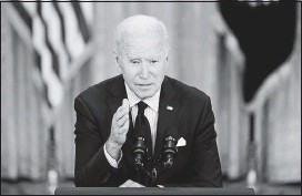 """?? THE ASSOCIATED PRESS ?? President Joe Biden spoke about the economy on Friday, saying his relief package was designed to help over the course of a year. """"We knew this wouldn't be a sprint,"""" he said."""