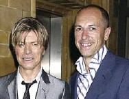 ?? DAVE BENNETT ?? The book's author, Dylan Jones, who is a longtime editor at GQ magazine, with David Bowie.