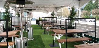 ??  ?? Earls has been busy transformi­ng outdoor spaces into dining areas, such as the parking lot at its Fir Street location, which is now Tanqueray Terrace, complete with greenery, picnic tables, and a tent.