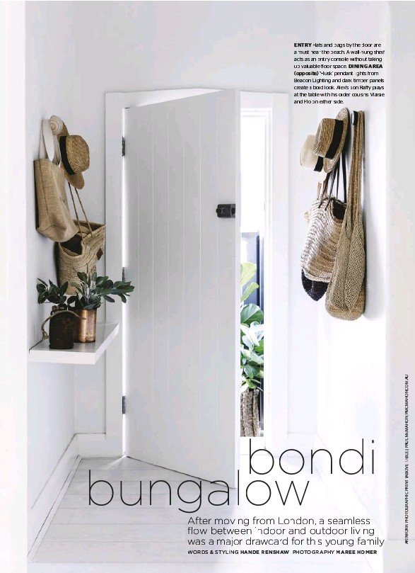 ??  ?? ENTRY Hats and bags by the door are a must near the beach. A wall-hung shelf acts as an entry console without taking up valuable floor space. DINING AREA (opposite) 'Husk' pendant lights from Beacon Lighting and dark timber panels create a bold look....