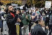?? Brian van der Brug Los Angeles Times ?? JOSEPH WILLIAM, left, a Black Lives Matter-L.A. organizer, at a Dec. 7 rally at the mayoral residence.
