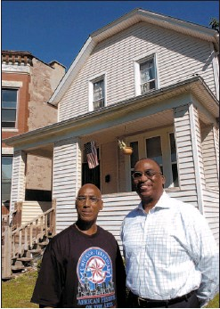 ??  ?? Johnny and Steve Rogers stand in front of 410 W. 60th Place. They grew up in the home, and now Steve has purchased the house.