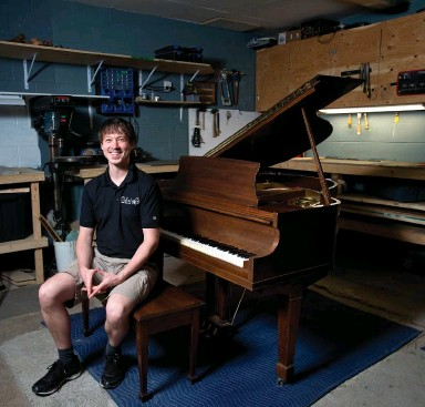 ??  ?? Mitch Oxford poses with a Mason & Risch baby grand piano that he restored at his workshop near Guelph.